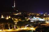 Tbilisi at night - Mtkvari river, Peace bridge and Mtatsminda mount