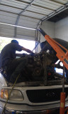 nate and cleo removing an engine