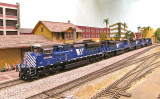 Athearn Genesis SD70ACes, MRL helper set passing the station.