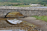 The town of Dornie, visible beyond the bridge to Eileen Donan Castle