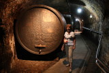 Jane next to one of the wine barrels