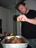 Dan adds spices to his ribs