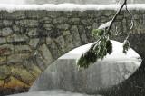 Snow falls over the Stoneman Bridge