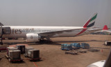 Emirates 777-300ER at gate at MAA
