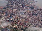 Conakry unfolds below us