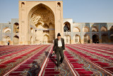 Man walking in Friday Mosque - Esfahan