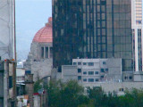 México City's Cathedral roof view of Revolution Monument dome (copper covered)