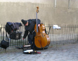 Montmartre - Contrabasso Player is Feeding Pigeons During Break