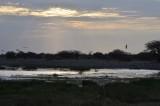 SUNSET AT THE NAMUTONI WATERHOLE