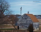 On the edge of Omaha stands this barn, the city keeps getting closer.