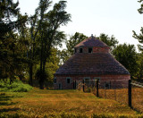 Not many round barns exist today but this old red block one is still standing.