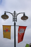 Lantern and coats of arms on the flags
