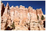 A hiker dwarfed by the hoodoos