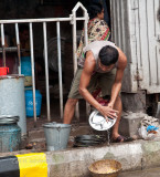 street vendor cleaning dishes