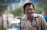 rickshaw driver having a smoke