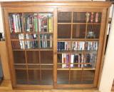 Oak bookcase with sliding doors