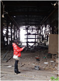 the abandoned shipyard and the photographer in red