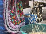 cleaning grain at the market, antigua, guatemala