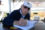 FIA3-27-2011 - Doolittle Raider, Col. Richard E Cole Autographing  Book on The Doolittle Raid