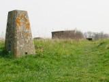 Next  to  the  triangulation  pillar  on  Monkham's  Hill