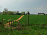 Over  the  footbridge  and  up  the  brae  to  Paris  Hall  Farm.