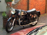 A  Norton  Dominator  500cc  outside  a  cafe.