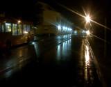 Nightlights  reflected  on  wet  roads.