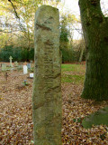 The  standing  stone  with  Runic  script.