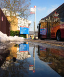 London  Bus  reflected  in  melting  snow.