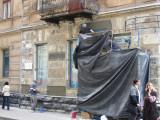 scraping the Soviet-era stucco off reveals the original surfaces