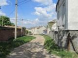 the next day, back on Valova street near the main square...