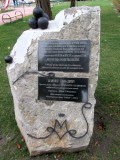 at a park on the riverfront, a historical marker about the naming of Mogilev...