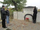 elsewhere in the cemetery, Mr. Wexler shows us a memorial to victims of a killing at a Soroca bridge
