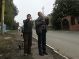 a passer-by points out some special features to Vitaly