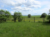the fields behind belonged with the property before Communist rule