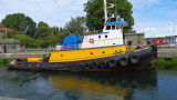 Hiram M. Chittenden Locks, Seattle, Washington. Water almost high enough for this Tugboat