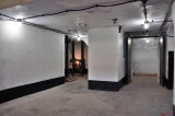 North view of powder room entrance on right & Vulcan hoist on left