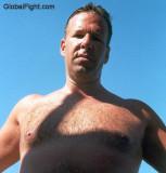 hairy man poolside swimming.jpeg