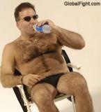 man suntanning beach poolside.jpg