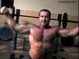 muscular bear bicep flexing.jpg