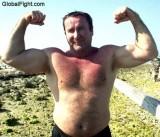 ocean beach muscle flexing.jpg