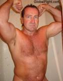 older man flexing shower.jpg