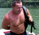 ruggedly handsome man boating.jpg