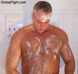 soapy muscle man showering.jpg