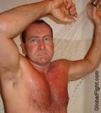 stocky older man showering.jpg