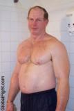 wet muscle man showering.jpg
