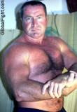 bicep flexing muscleman daddy.jpg
