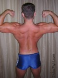 flexing big back muscles.jpg