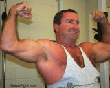 hairy musclebear daddy flexing.jpg