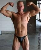 muscle dude speedos flexing.jpg